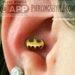 Fresh 14g conch piercing with a 14k yellow gold Batman symbol. Jewelry from BVLA.  Piercing by AJ.