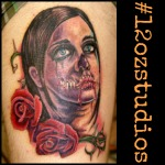 Amazing zombie with roses tattoo by Alex Feliciano.