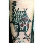 Baba Yaga house cover-up tattoo by Rebecca La Norma.