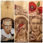 Just some of the colored pencil on wood portraits by Bobby Trefz that were available at the convention.